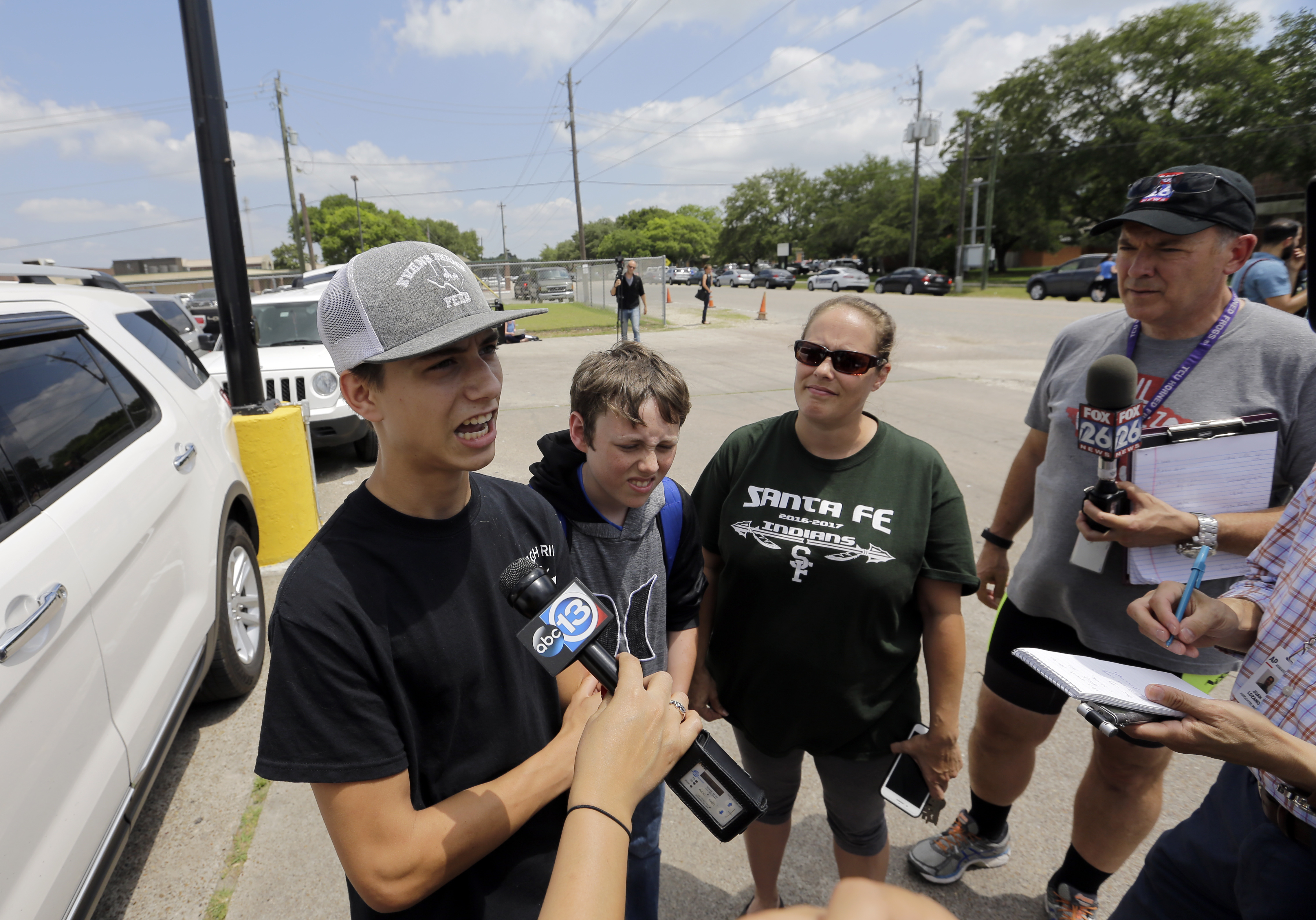 <div class='meta'><div class='origin-logo' data-origin='AP'></div><span class='caption-text' data-credit='AP'>Santa Fe High School senior Logan Roberds, left, talks to reporters outside the Alamo Gym Friday, May 18, 2018, in Santa Fe, Texas. (AP Photo/David J. Phillip)</span></div>