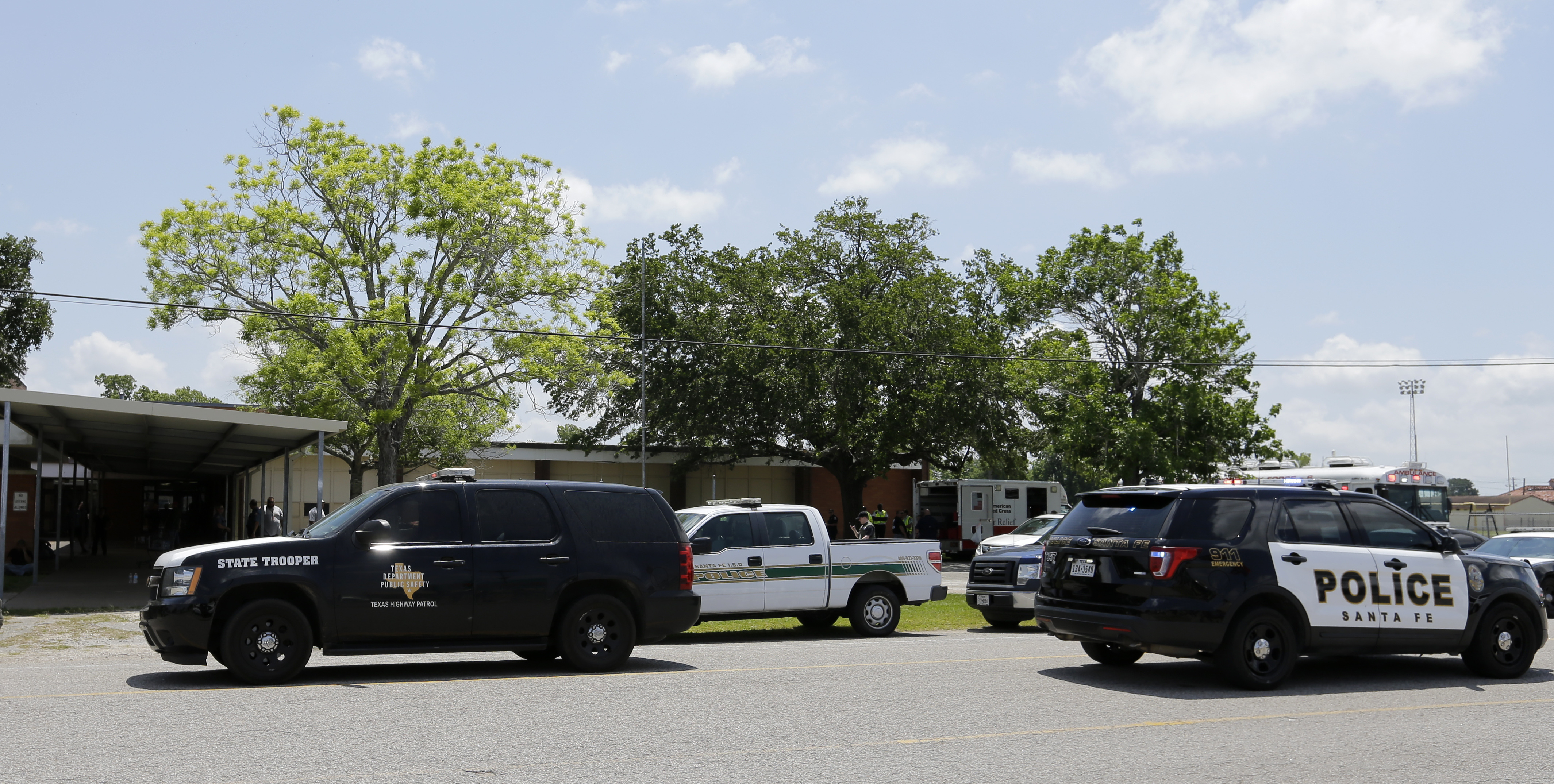 <div class='meta'><div class='origin-logo' data-origin='AP'></div><span class='caption-text' data-credit='AP'>Law enforcement vehicles are parked outside the Alamo Gym where students and parents wait to reunite, May 18, 2018 (AP Photo/David J. Phillip)</span></div>