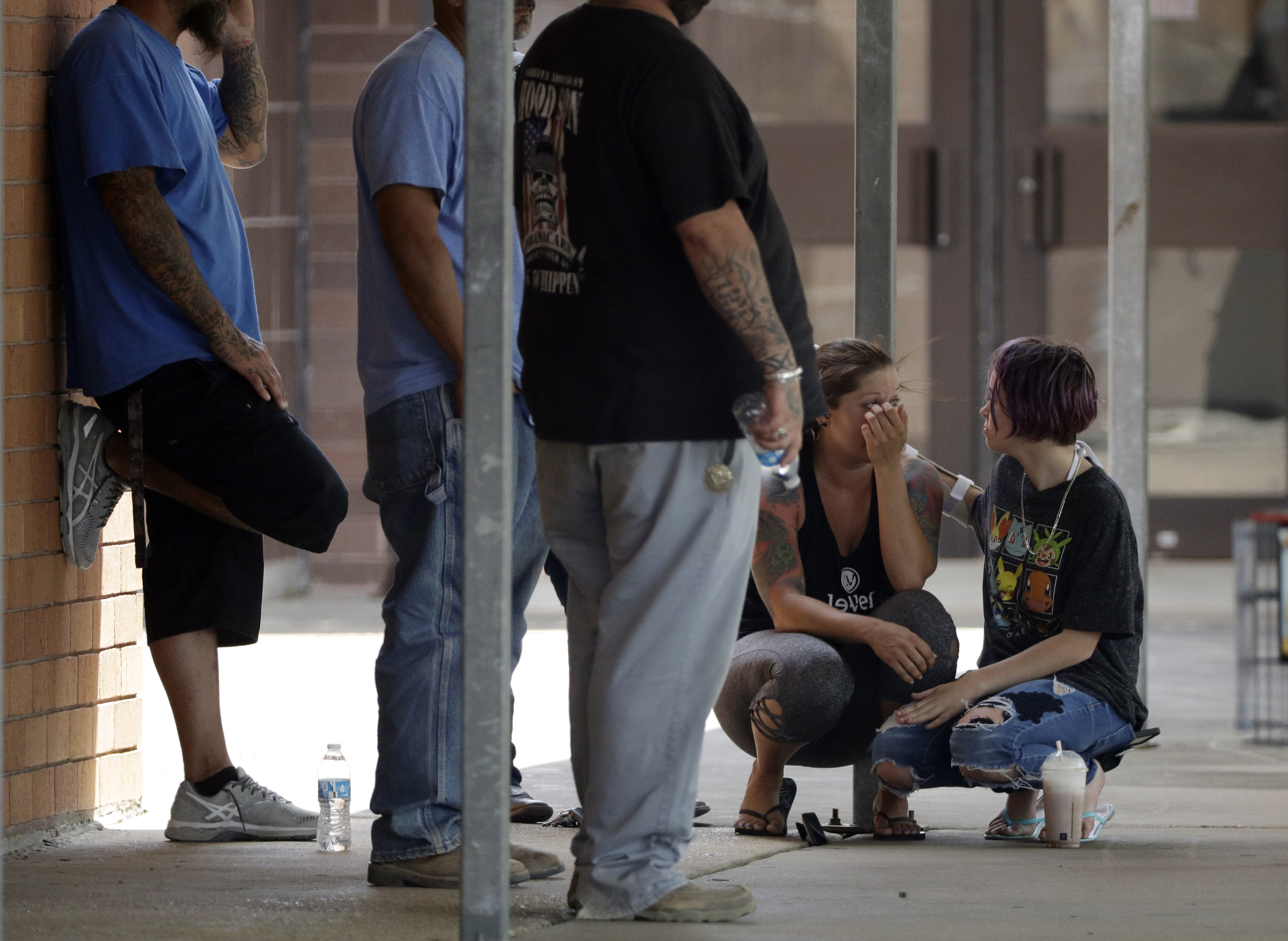 <div class='meta'><div class='origin-logo' data-origin='AP'></div><span class='caption-text' data-credit='AP'>People react outside the unification center at the Alamo Gym, following a shooting at Santa Fe High School Friday, May 18, 2018, in Santa Fe, Texas. (AP Photo/David J. Phillip)</span></div>