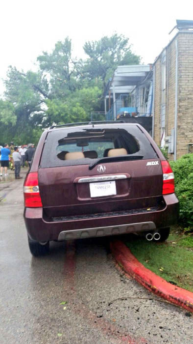 <div class='meta'><div class='origin-logo' data-origin='none'></div><span class='caption-text' data-credit='Photo/Steve Campion'>A tornado may be to blame for this damage at a southwest Houston apartment complex</span></div>