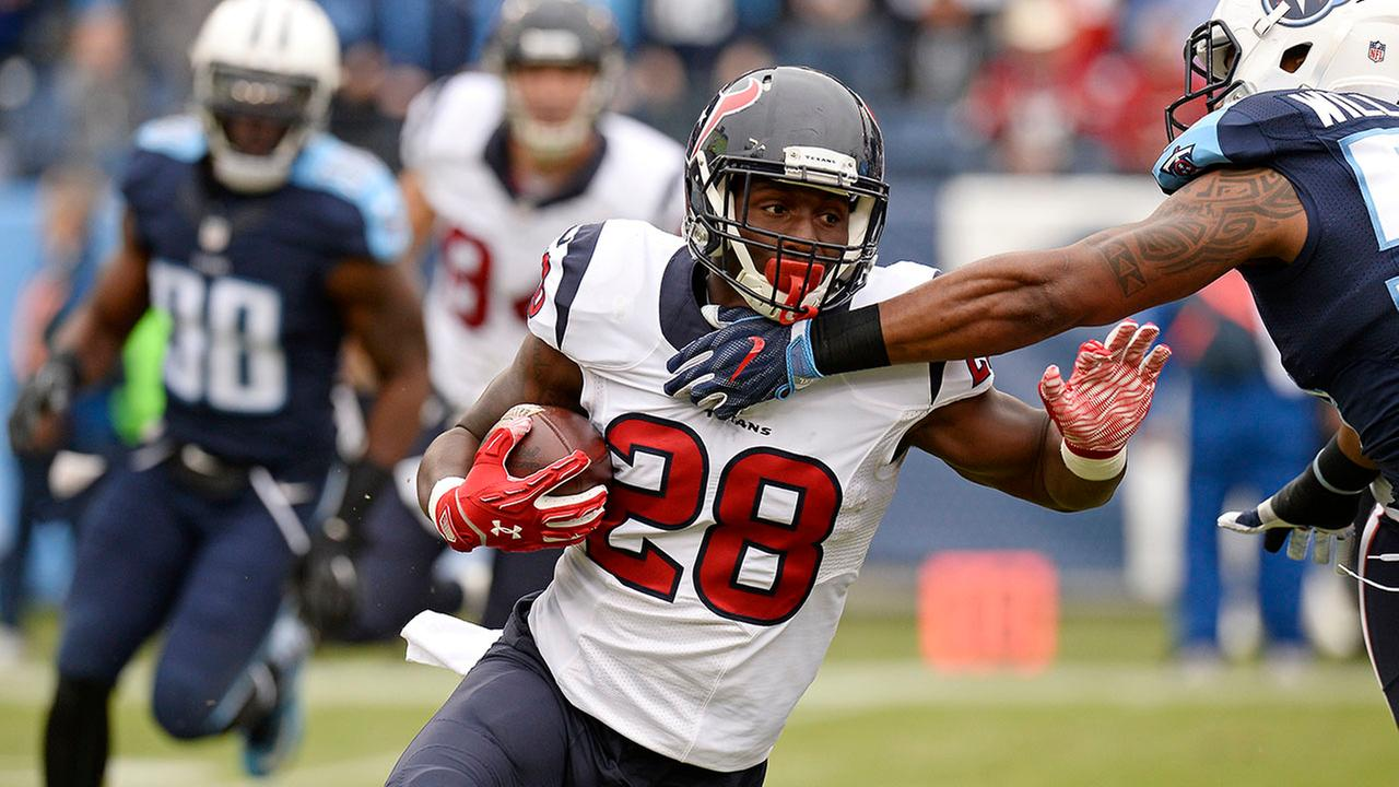 Houston Texans running back Alfred Blue (28) runs the ball against the Tennessee Titans in the first half of an NFL football game Sunday, Jan. 1, 2017, in Nashville, Tenn.AP
