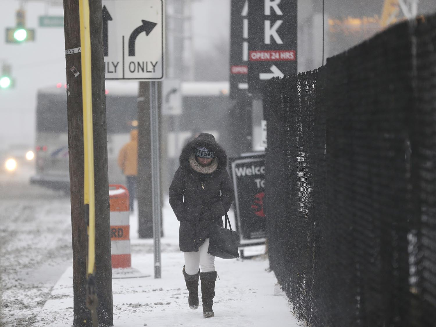 <div class='meta'><div class='origin-logo' data-origin='AP'></div><span class='caption-text' data-credit='AP Photo/Seth Wenig'>A woman makes her way through the snow and wind in Hoboken, N.J., Thursday, Jan. 4, 2018.</span></div>