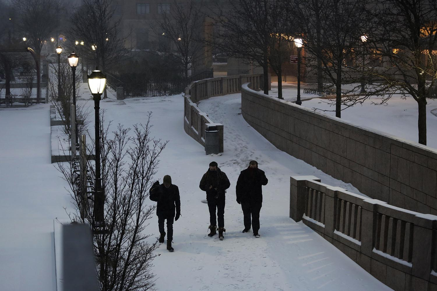 <div class='meta'><div class='origin-logo' data-origin='AP'></div><span class='caption-text' data-credit='AP Photo/Mark Lennihan'>Men walk through an early morning snowfall, Thursday, Jan. 4, 2018, in New York.</span></div>