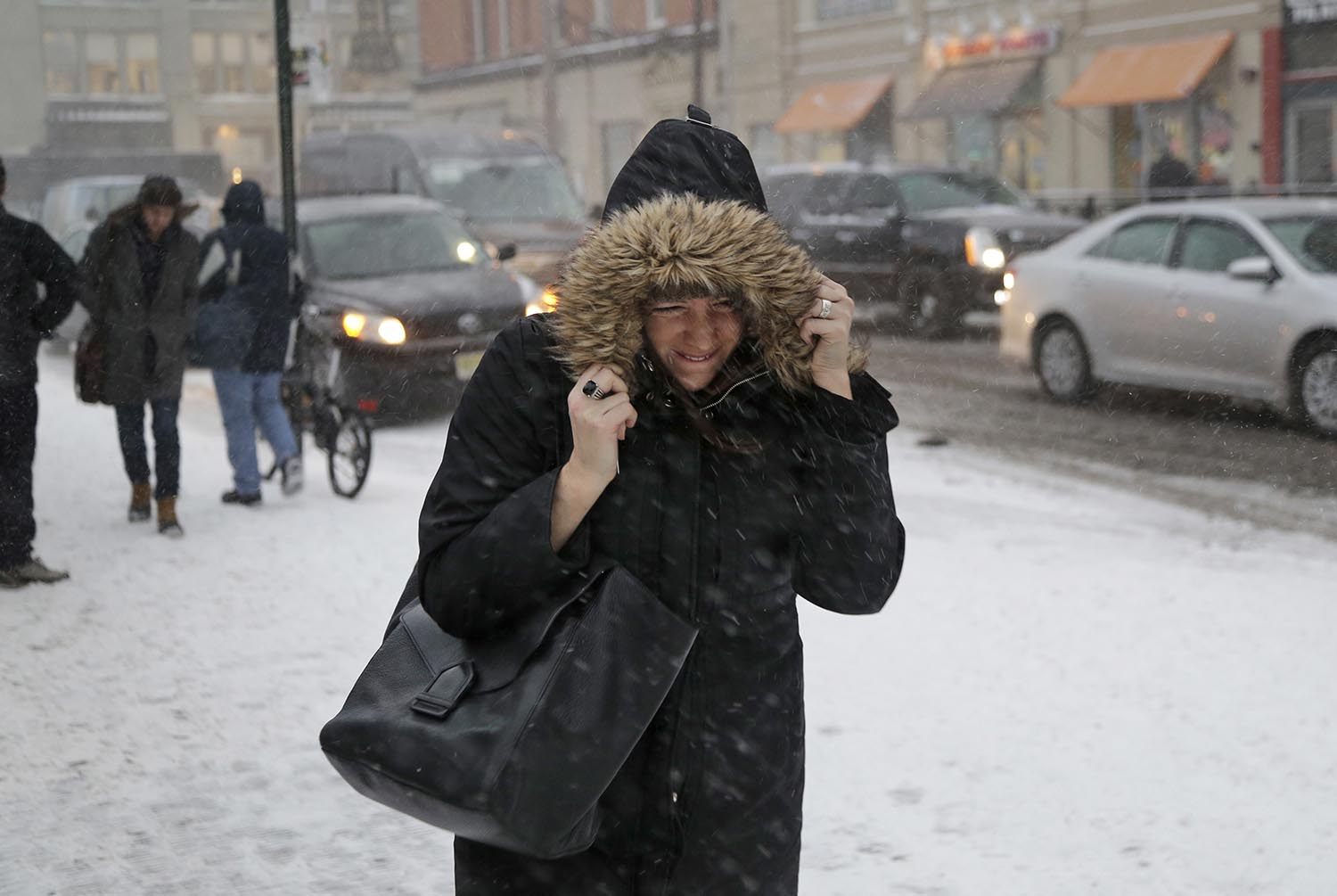 <div class='meta'><div class='origin-logo' data-origin='AP'></div><span class='caption-text' data-credit='AP Photo/Seth Wenig'>A woman walks through the snow and wind as she makes her way to the train station in Hoboken, N.J., Thursday, Jan. 4, 2018.</span></div>