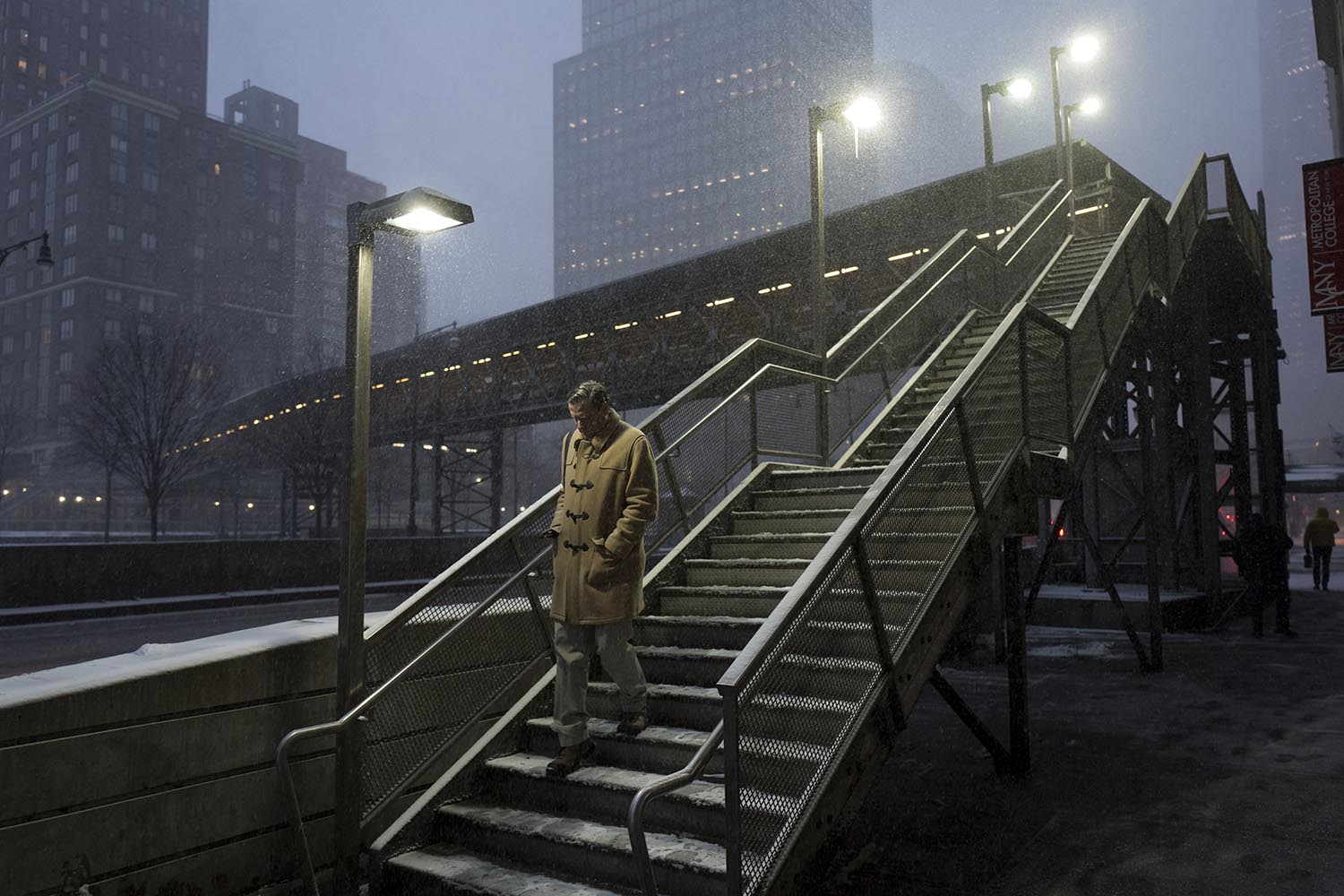 <div class='meta'><div class='origin-logo' data-origin='AP'></div><span class='caption-text' data-credit='AP Photo/Mark Lennihan'>A man walks down a staircase through an early morning snowfall, Thursday, Jan. 4, 2018, in New York.</span></div>