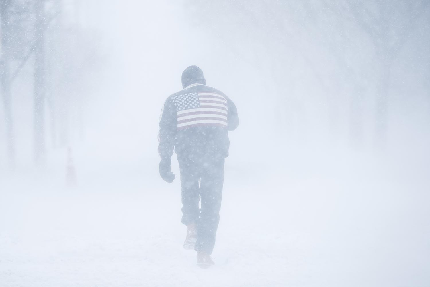 <div class='meta'><div class='origin-logo' data-origin='AP'></div><span class='caption-text' data-credit='AP Photo/Matt Rourke'>A man pushes his way through driving winds during a winter snowstorm in Atlantic City, N.J., Thursday, Jan. 4, 2018.</span></div>