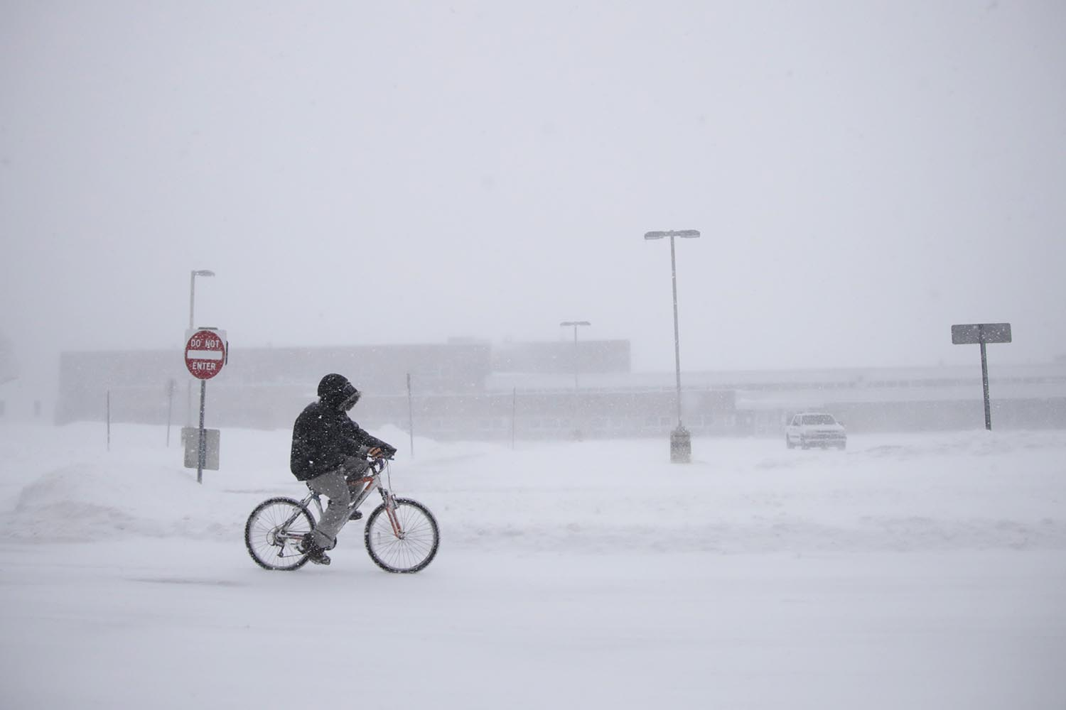<div class='meta'><div class='origin-logo' data-origin='AP'></div><span class='caption-text' data-credit='AP Photo/Julio Cortez'>Justin Hartman rides his bicycle along New Bedford Road in whiteout conditions during a snowstorm, Thursday, Jan. 4, 2018, in Wall Township, N.J.</span></div>