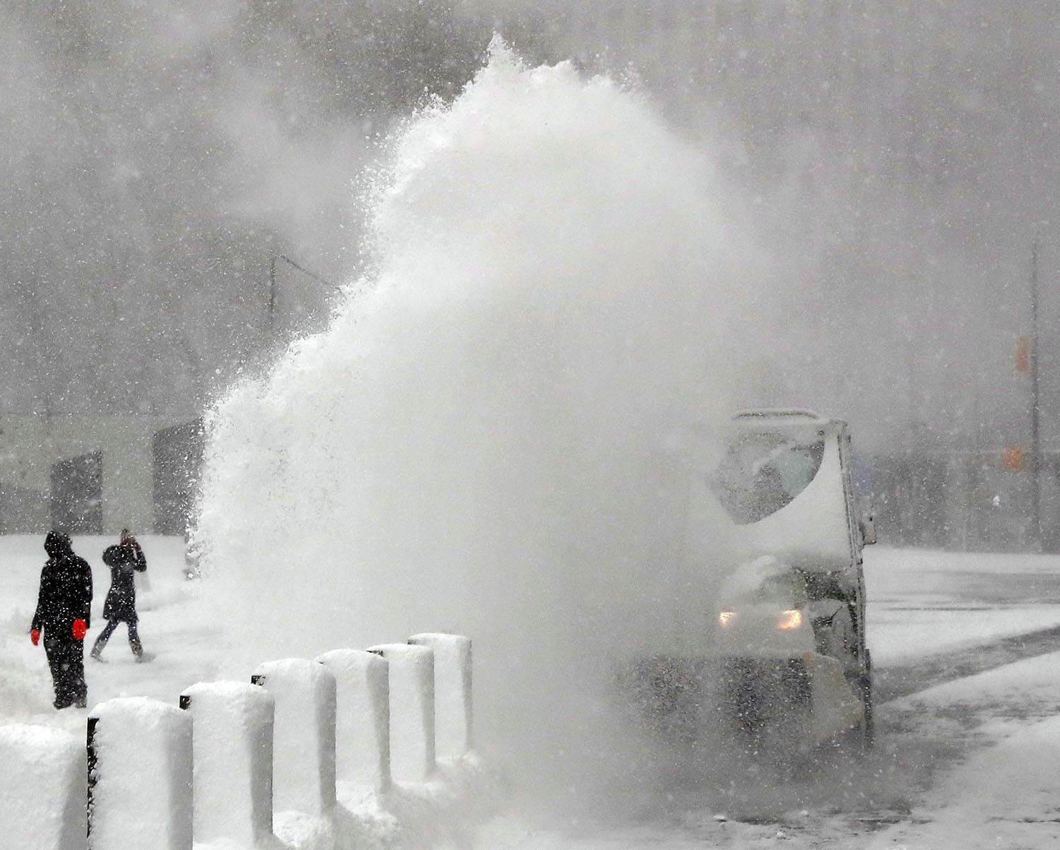 <div class='meta'><div class='origin-logo' data-origin='AP'></div><span class='caption-text' data-credit='AP Photo/Kathy Willens'>A worker clears snow from a plaza in lower Manhattan in New York, Thursday, Jan. 4, 2018 as a powerful winter storm buffeted the area with high winds and blowing snow.</span></div>