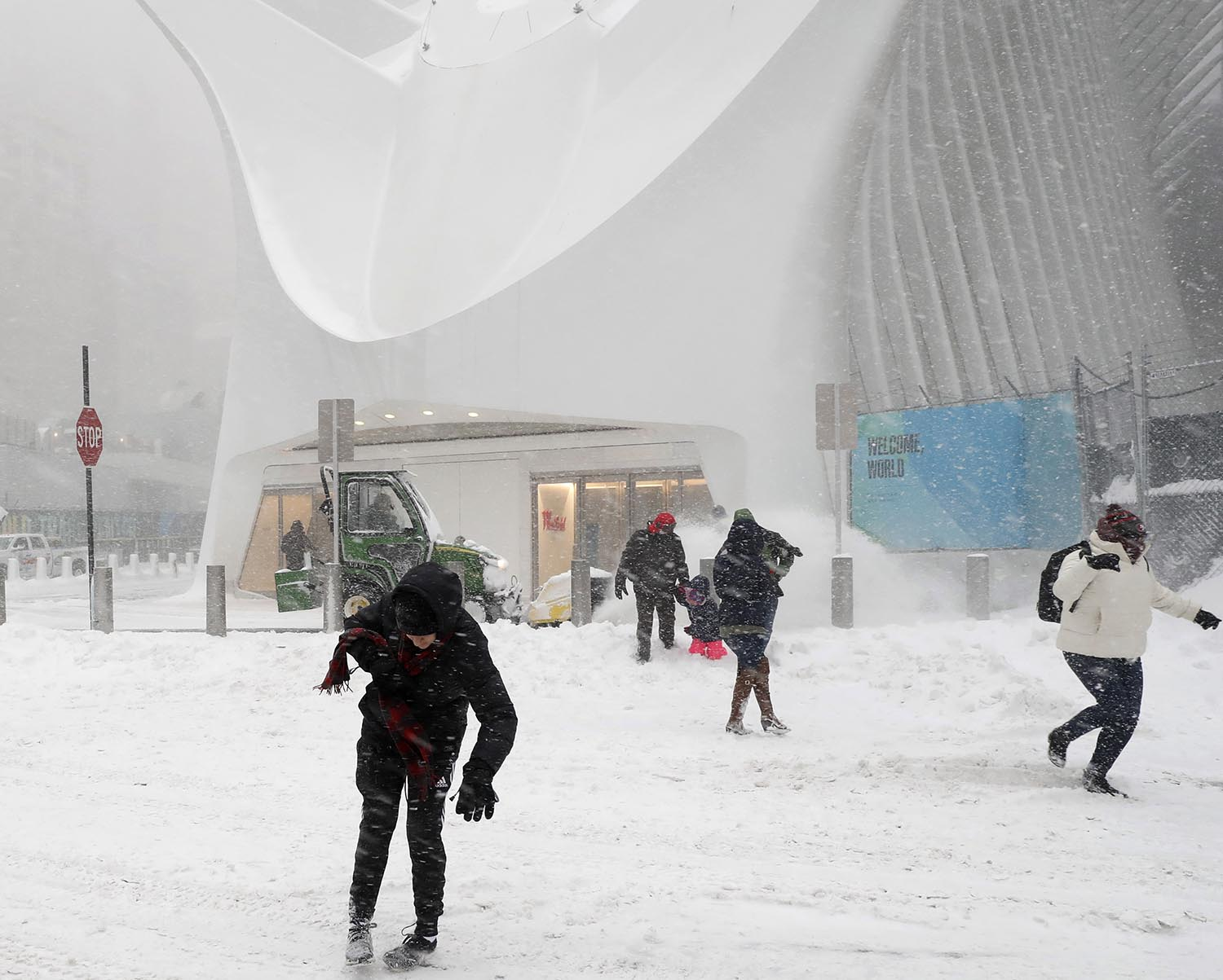 <div class='meta'><div class='origin-logo' data-origin='AP'></div><span class='caption-text' data-credit='AP Photo/Kathy Willens'>People walk through a snowstorm as they exit the Oculus at the Fulton Street transit hub beneath the World Trade Center in New York, Thursday, Jan. 4, 2018.</span></div>