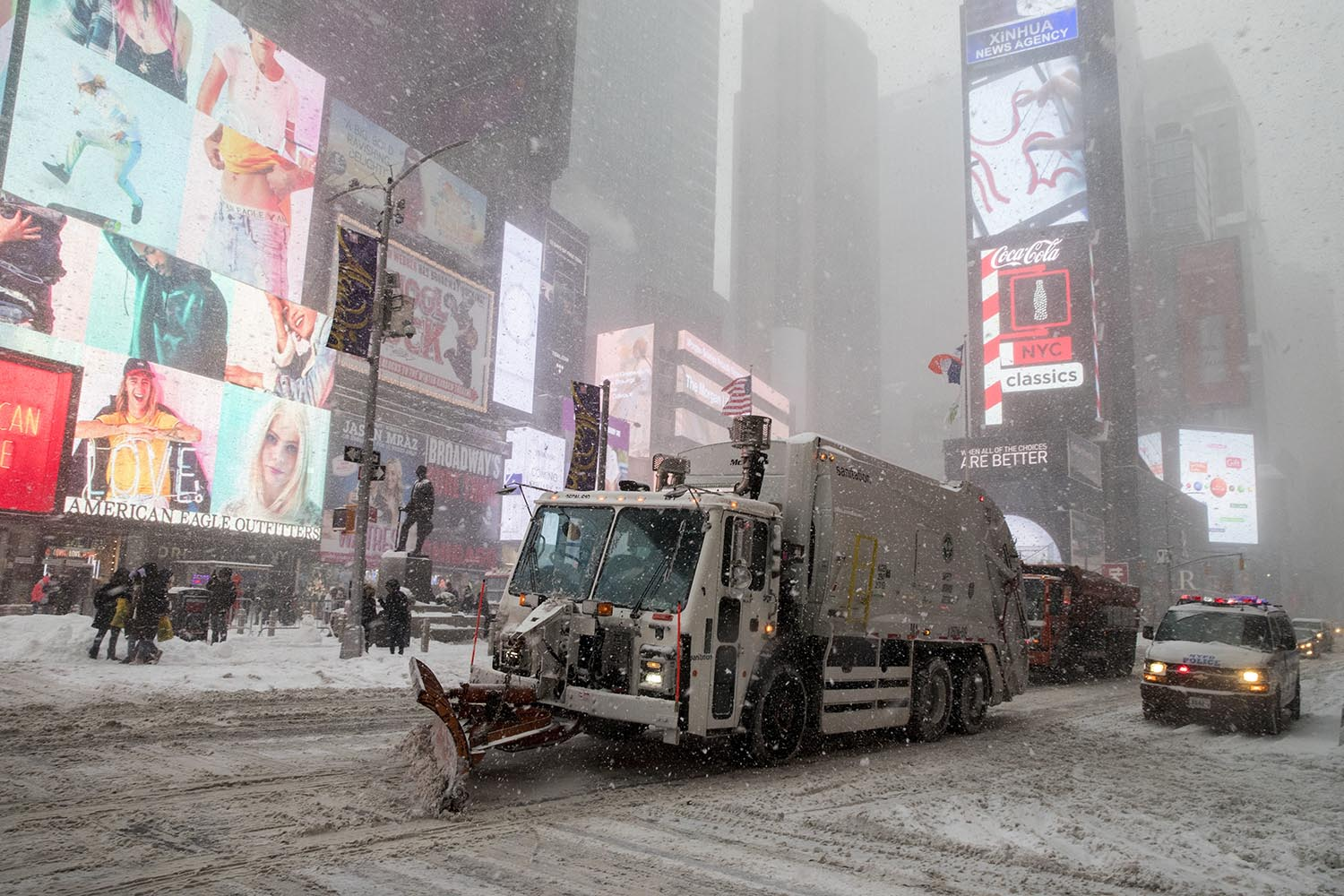 <div class='meta'><div class='origin-logo' data-origin='AP'></div><span class='caption-text' data-credit='AP Photo/Mary Altaffer'>A snow plow clears snow off Broadway in New York's Times Square, Thursday, Jan. 4, 2018.</span></div>
