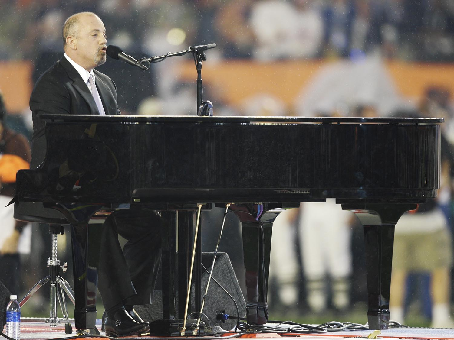 <div class='meta'><div class='origin-logo' data-origin='AP'></div><span class='caption-text' data-credit='AP Photo/Alex Brandon'>2007: Billy Joel sings the national anthem prior to the Super Bowl XLI football game at Dolphin Stadium in Miami on Sunday, Feb. 4, 2007.</span></div>