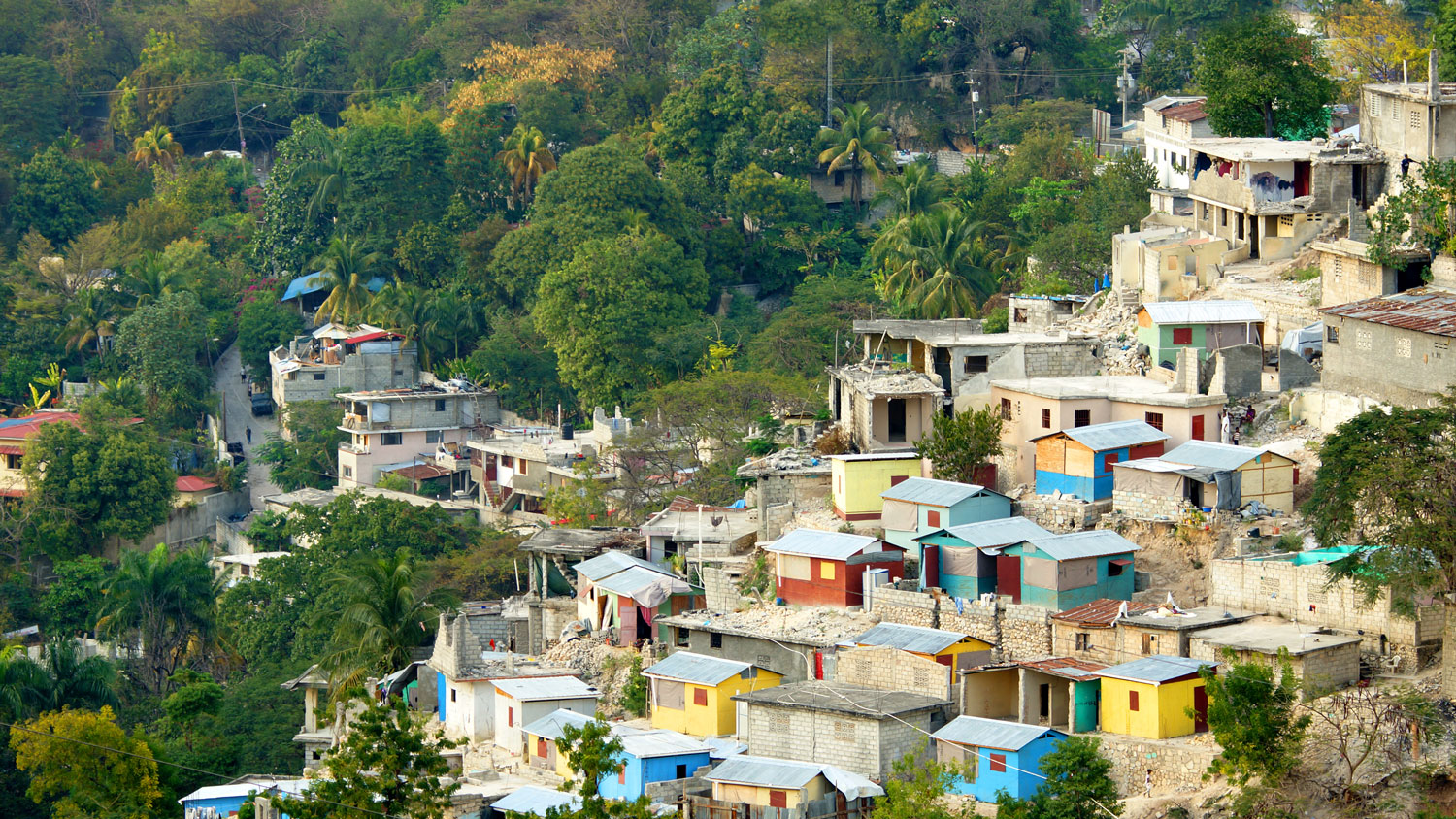 "<div class=""meta image-caption""><div class=""origin-logo origin-image none""><span>none</span></div><span class=""caption-text"">Buildings sit on a hill in a rural town of Haiti. (Shutterstock)</span></div>"