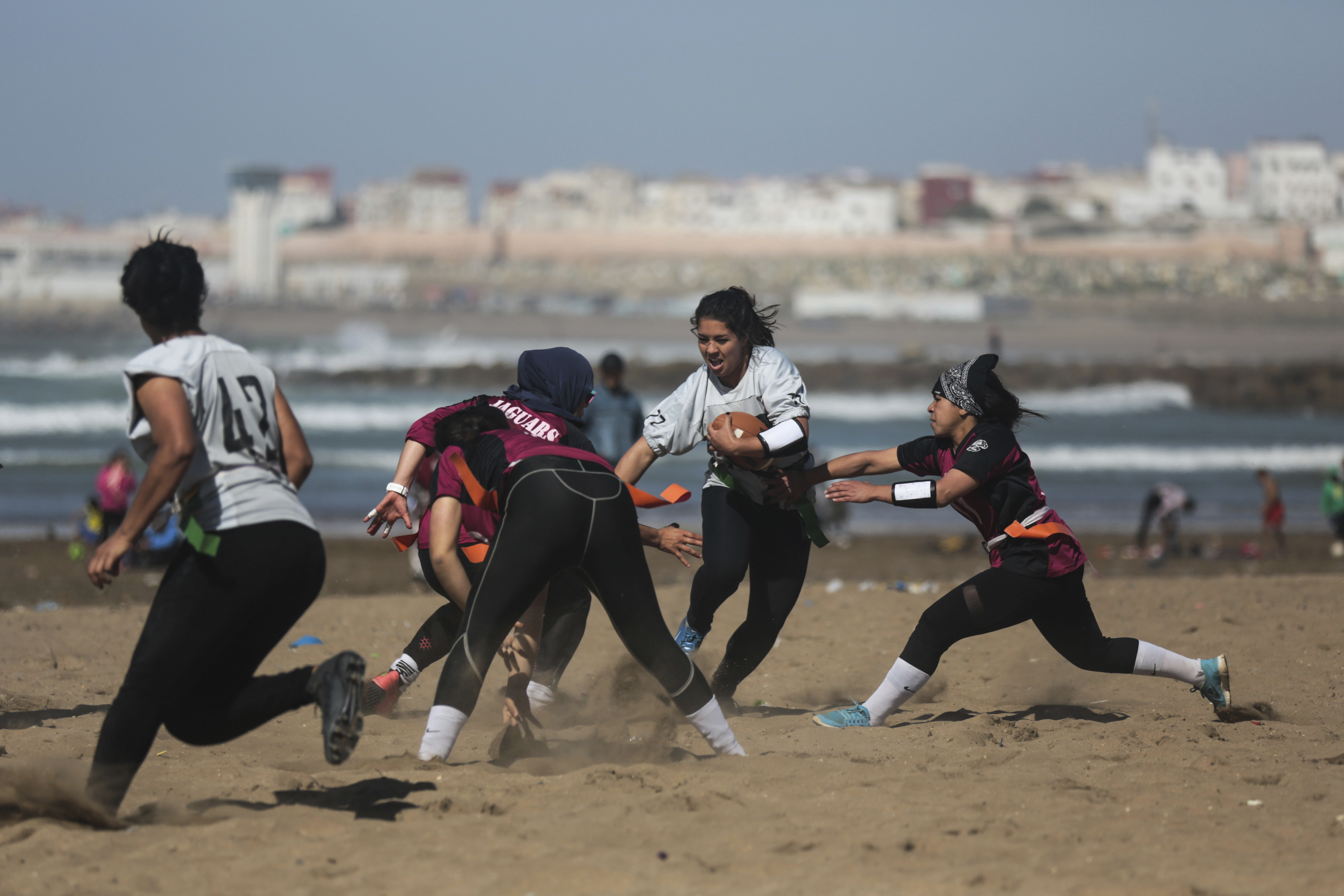 "<div class=""meta image-caption""><div class=""origin-logo origin-image ap""><span>AP</span></div><span class=""caption-text"">Girls play flag football on a beach in Rabat, Morocco (AP)</span></div>"