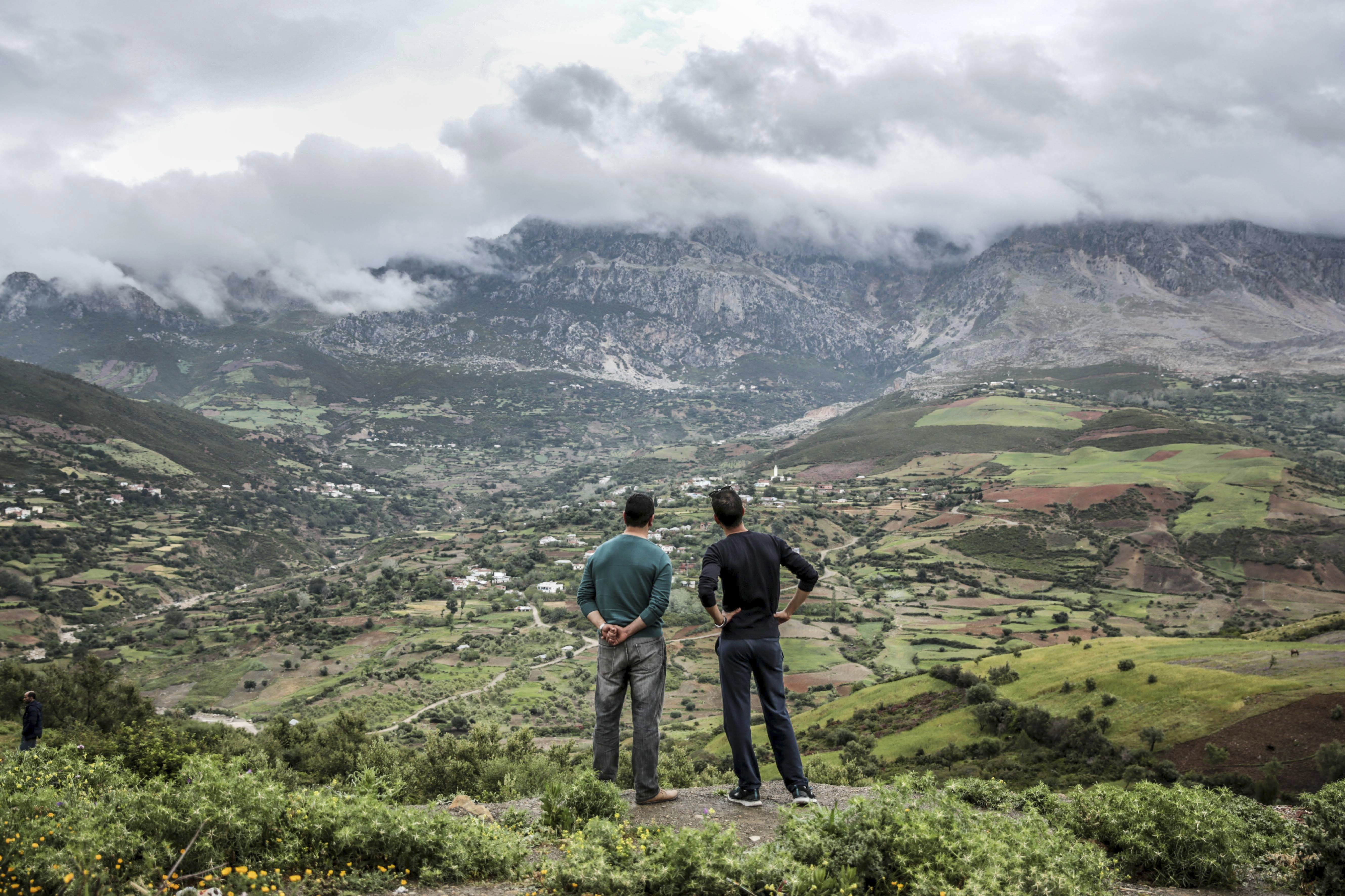 "<div class=""meta image-caption""><div class=""origin-logo origin-image ap""><span>AP</span></div><span class=""caption-text"">Two men observe rainclouds hanging over the Rif mountains near Tetouan, northern Morocco (AP)</span></div>"