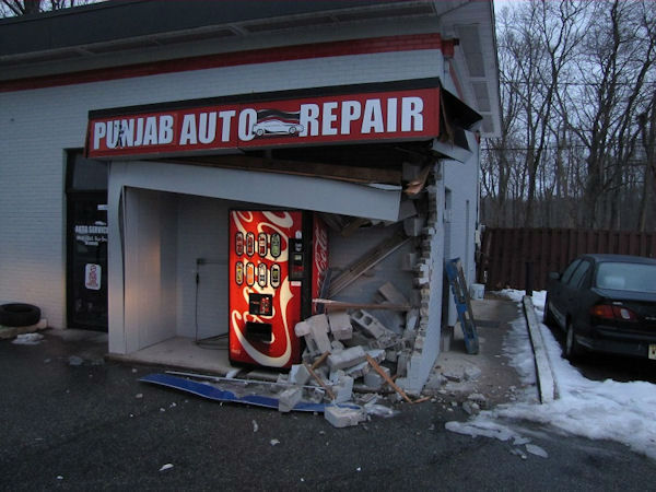 """<div class=""""meta image-caption""""><div class=""""origin-logo origin-image none""""><span>none</span></div><span class=""""caption-text"""">A sanitation truck slid on ice and hit a building at a gas station along Route 1 in South Brunswick.</span></div>"""