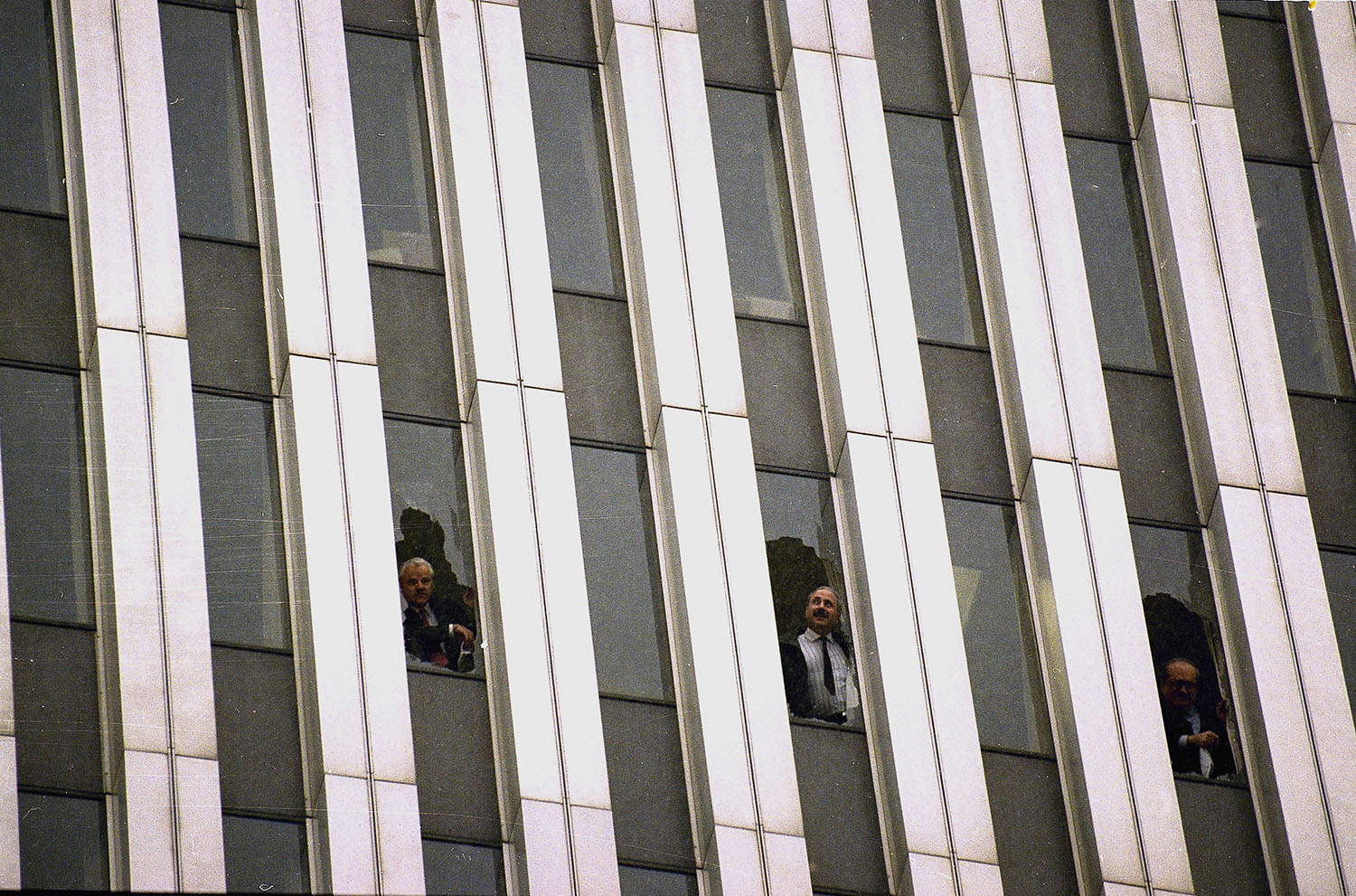 <div class='meta'><div class='origin-logo' data-origin='AP'></div><span class='caption-text' data-credit='AP Photo/Alex Brandon'>Workers peer through broken windows of the World Trade Center in New York, Feb. 26, 1993, after an explosion in an underground garage rocked the twin towers complex.</span></div>
