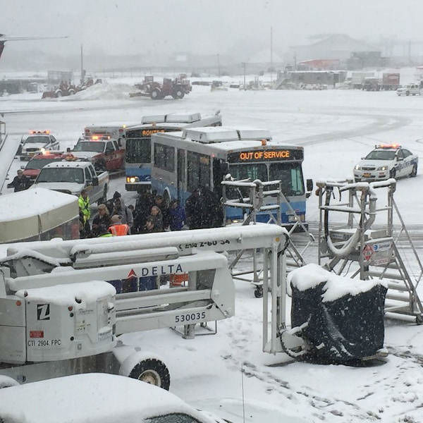 <div class='meta'><div class='origin-logo' data-origin='none'></div><span class='caption-text' data-credit=''>Photos of a plane that skidded off the runway at LaGuardia Airport on March 5, 2015.  (Photo by @auroraborealis_ via Instagram)</span></div>