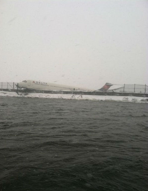 <div class='meta'><div class='origin-logo' data-origin='none'></div><span class='caption-text' data-credit=''>Photos of a plane that skidded off the runway at LaGuardia Airport on March 5, 2015. (Courtesy FDNY)</span></div>
