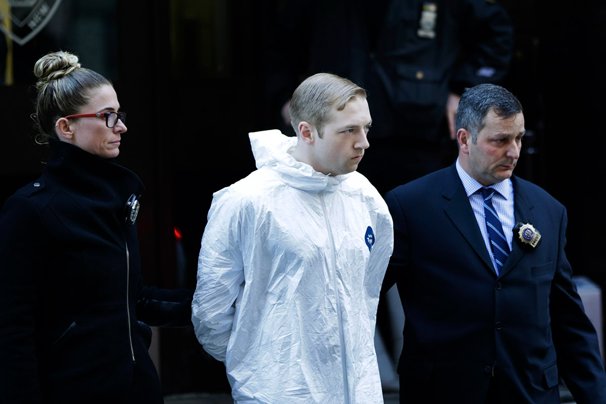 <div class='meta'><div class='origin-logo' data-origin='AP'></div><span class='caption-text' data-credit='AP Photo/Seth Wenig'>James Harris Jackson is escorted out of a police precinct in New York, Wednesday, March 22, 2017.</span></div>