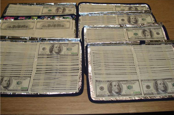 "<div class=""meta image-caption""><div class=""origin-logo origin-image none""><span>none</span></div><span class=""caption-text"">Photos of counterfeit $100 bills found concealed in place mats and a shoe bag at JFK Airport's International Mail facility.</span></div>"