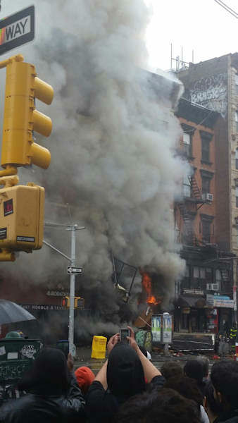 <div class='meta'><div class='origin-logo' data-origin='none'></div><span class='caption-text' data-credit=''>There was an explosion and partial collapse at an apartment building in Manhattan Thursday.</span></div>