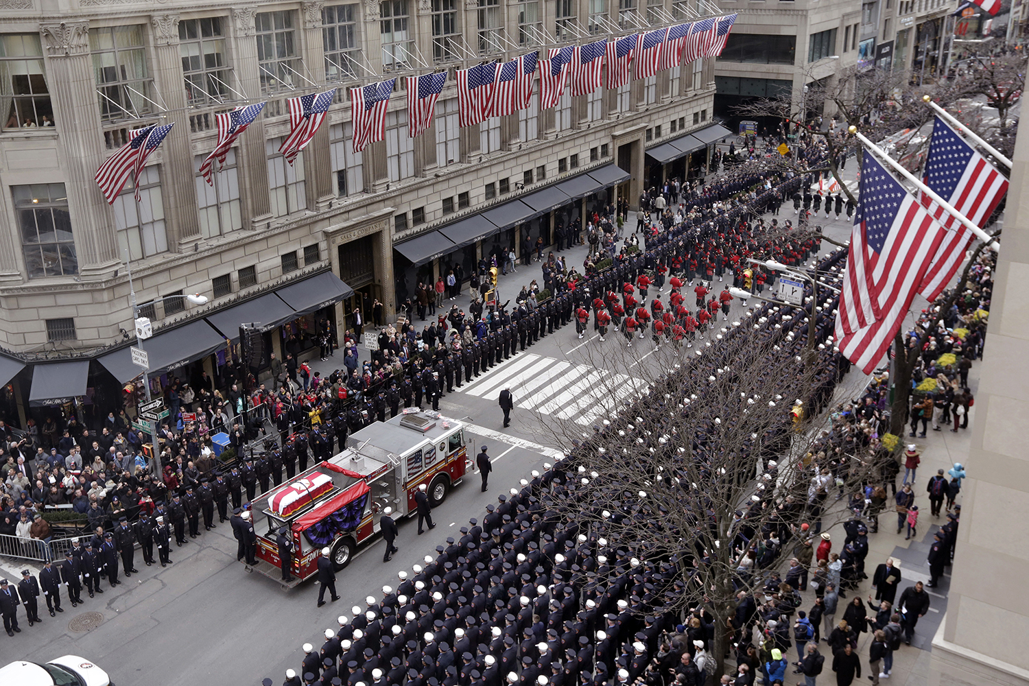 <div class='meta'><div class='origin-logo' data-origin='AP'></div><span class='caption-text' data-credit='Richard Drew'>The casket of New York City firefighter Michael Davidson is carried on a fire truck down Fifth Avenue as it leaves St. Patrick's Cathedral after his funeral.</span></div>