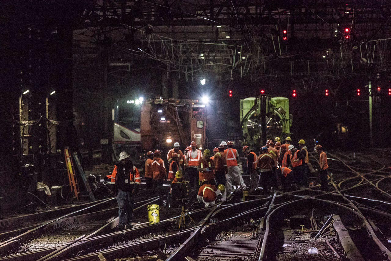 <div class='meta'><div class='origin-logo' data-origin='none'></div><span class='caption-text' data-credit='Photo/Amtrak'>Amtrak released this photo showing workers repairing equipment at Penn Station. The truck in the back is a truck vacuum sucking out ballast so ties can be removed and replaced.</span></div>