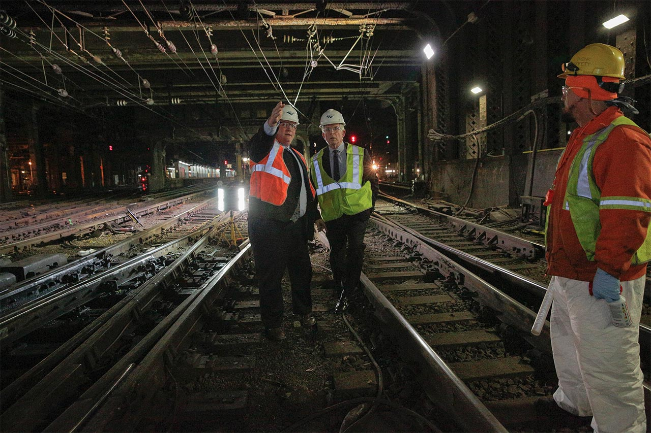 <div class='meta'><div class='origin-logo' data-origin='none'></div><span class='caption-text' data-credit='Photo/Amtrak'>Amtrak President and CEO Wick Moorman (right) and Amtrak Deputy General Manager Steve Young assess the tracks at New York Penn Station.</span></div>