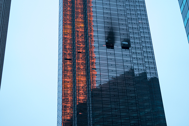 <div class='meta'><div class='origin-logo' data-origin='AP'></div><span class='caption-text' data-credit=''>Fire damage is seen on a side of Trump Tower in New York on Saturday, April 7, 2018. (AP Photo/Craig Ruttle)</span></div>