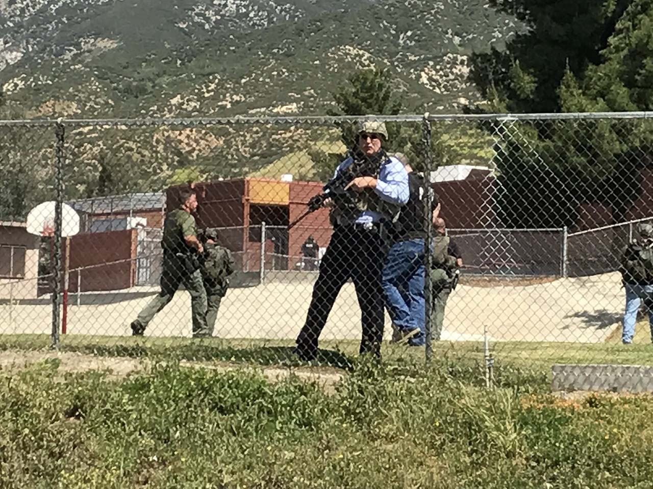 <div class='meta'><div class='origin-logo' data-origin='none'></div><span class='caption-text' data-credit='Photo/Rick Sforza with Southern California News Group'>Police lined the perimeter of North Park elementary following a shooting inside a classroom.</span></div>