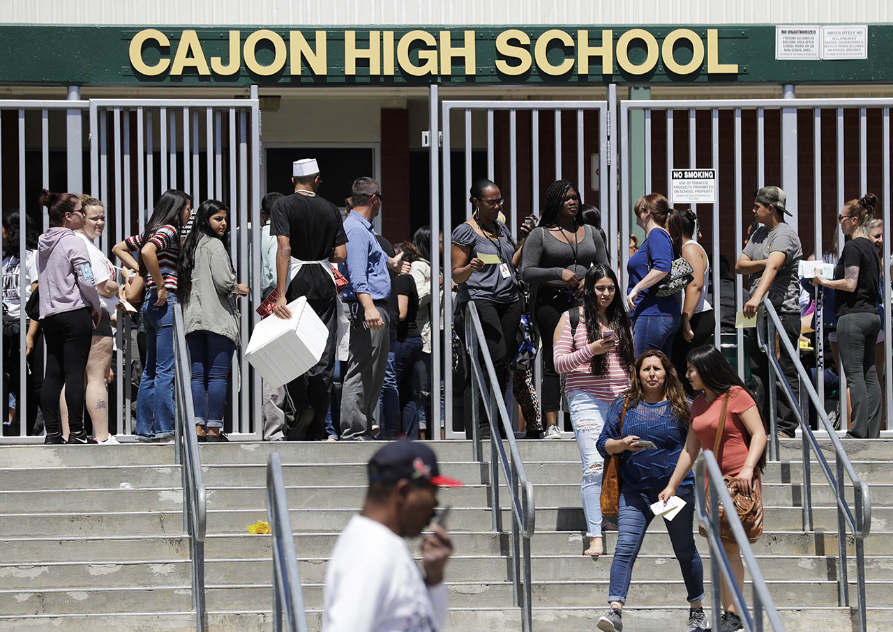 <div class='meta'><div class='origin-logo' data-origin='AP'></div><span class='caption-text' data-credit='AP Photo/Jae C. Hong'>Parents and guardians of North Park Elementary School students wait at Cajon High School to pick up their children Monday, April 10, 2017, in San Bernardino, California.</span></div>