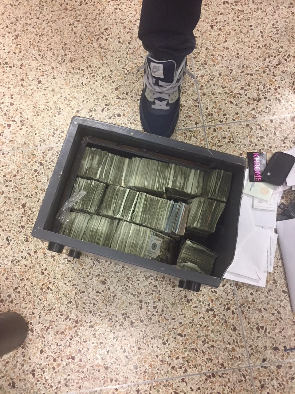 <div class='meta'><div class='origin-logo' data-origin='WABC'></div><span class='caption-text' data-credit=''>Photos of cash, weapons and cars seized in Brooklyn drug bust on April 10, 2018.</span></div>