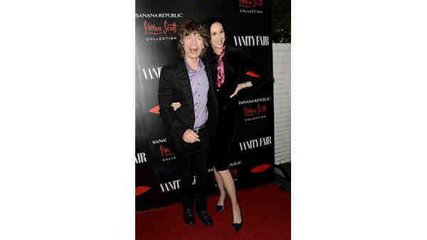 Fashion Designer L&#39;Wren Scott, pictured here with partner Mick Jagger, died Mar. 17, 2014. She was 49. <span class=meta>(Photo by Dan Steinberg&#47;Invision&#47;AP, File)</span>