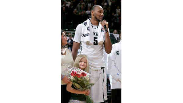 Michigan State fan Lacey Holsworth who had her story told during the recent NCAA basketball tournament died of cancer on Wednesday, April 9, 2014 at the age of 8.