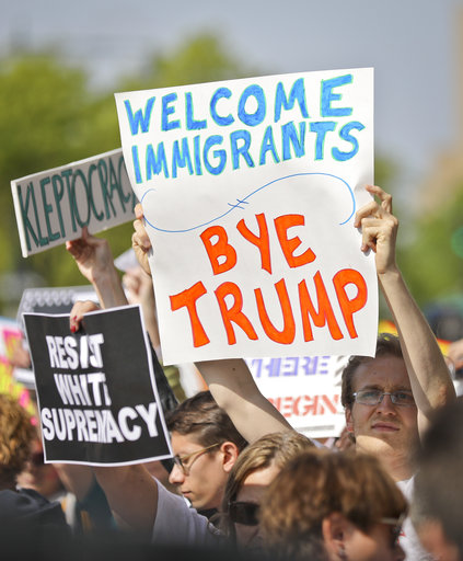 "<div class=""meta image-caption""><div class=""origin-logo origin-image ap""><span>AP</span></div><span class=""caption-text"">Protesters rally near the Intrepid Air and Sea Museum where President Trump is expected to visit, Thursday May 4, 2017, in New York. (AP Photo/Bebeto Matthews)</span></div>"