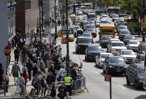 "<div class=""meta image-caption""><div class=""origin-logo origin-image ap""><span>AP</span></div><span class=""caption-text"">A crowd of protesters are penned up across the street from the Intrepid, where President Donald Trump is expected to attend a Commemorative Dinner on Thursday, May 4, 2017 (AP Photo/Julio Cortez)</span></div>"