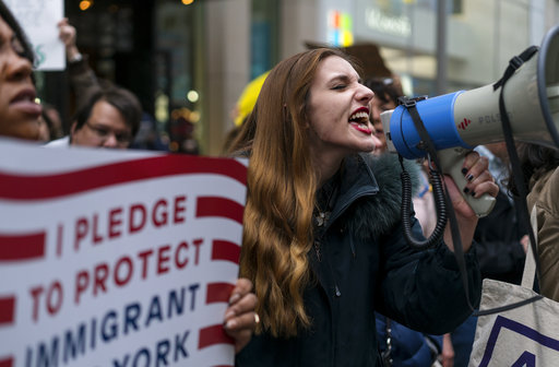 "<div class=""meta image-caption""><div class=""origin-logo origin-image ap""><span>AP</span></div><span class=""caption-text"">Protesters gather on 5th Avenue, near Trump Tower. President Donald Trump is slated to attend an event in New York on Thursday aboard the Intrepid on Thursday, May 4, 2017. (AP Photo/Craig Ruttle)</span></div>"