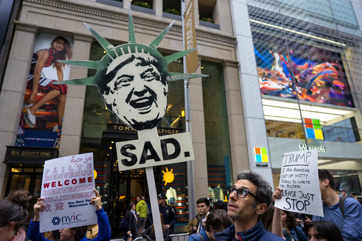 "<div class=""meta image-caption""><div class=""origin-logo origin-image ap""><span>AP</span></div><span class=""caption-text"">Protesters gather near Trump Tower. President Donald Trump is slated to attend an event in New York on Thursday aboard the Intrepid for a Commemorative Dinner on May 4, 2017. (AP Photo/Craig Ruttle)</span></div>"