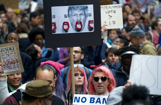 "<div class=""meta image-caption""><div class=""origin-logo origin-image ap""><span>AP</span></div><span class=""caption-text"">Protesters gather near Trump Tower on May 4, 2017. President Donald Trump is slated to attend a Commemorative Dinner in New York on Thursday aboard the Intrepid. (AP Photo/Craig Ruttle)</span></div>"