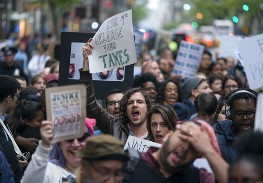 "<div class=""meta image-caption""><div class=""origin-logo origin-image ap""><span>AP</span></div><span class=""caption-text"">Protesters gather on 5th Avenue near Trump Tower. President Donald Trump is slated to attend an event in New York on Thursday aboard the Intrepid for a Commemorative Dinner. (AP Photo/Craig Ruttle)</span></div>"