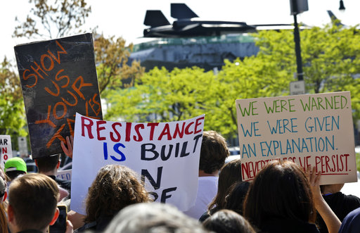 "<div class=""meta image-caption""><div class=""origin-logo origin-image ap""><span>AP</span></div><span class=""caption-text"">Protesters rally near the Intrepid Air and Sea Museum where President Trump is expected to visit Thursday May 4, 2017, in New York. (AP Photo/Bebeto Matthews)</span></div>"