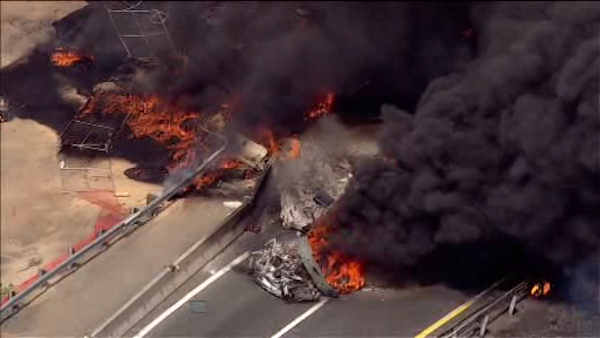 A tanker truck overturned and caught fire Tuesday on the New Jersey Turnpike in Woodbridge. <span class=meta></span>