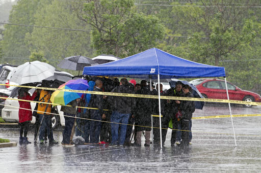 <div class='meta'><div class='origin-logo' data-origin='AP'></div><span class='caption-text' data-credit='AP Photo/Jose Luis Magana'>Assistant Montgomery County, Md. Police Chief Darryl McSwain speaks to reporters under a tent during a heavy rain outside the Westfield Montgomery Mall in Bethesda, Md.</span></div>