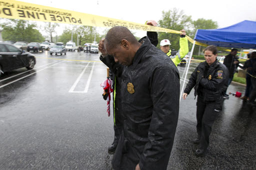 <div class='meta'><div class='origin-logo' data-origin='AP'></div><span class='caption-text' data-credit='AP Photo/Jose Luis Magana'>Assistant Montgomery County, Md. Police Chief Darryl McSwain leaves after speaking to reporters under a tent during a heavy rain outside Westfield Montgomery Mall in Bethesda, Md.</span></div>