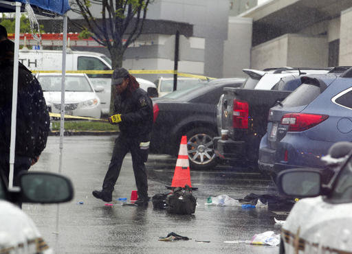 <div class='meta'><div class='origin-logo' data-origin='AP'></div><span class='caption-text' data-credit='AP Photo/Jose Luis Magana'>A Montgomery County Md. Police officer marks evidence after a shooting outside the Westfield Montgomery Mall in Bethesda, Md., Friday, May 6, 2016.</span></div>