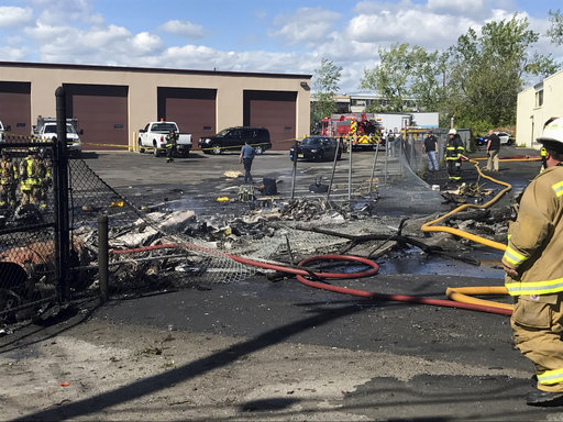 <div class='meta'><div class='origin-logo' data-origin='AP'></div><span class='caption-text' data-credit='Joe Orlando/Town of Carlstadt via AP'>In this image provided by the Town of Carlstadt firefighters respond after a jet crashed into a building near Teterboro Airport in Carlstadt, N.J., Monday, May 15, 2017.</span></div>