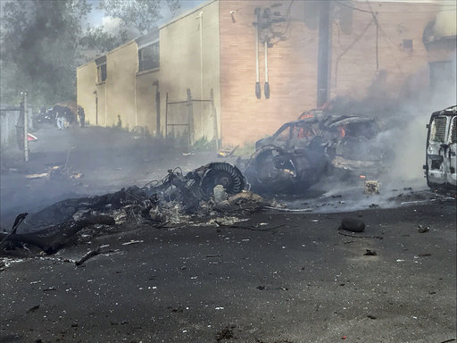 <div class='meta'><div class='origin-logo' data-origin='AP'></div><span class='caption-text' data-credit='Joe Orlando/Town of Carlstadt via AP'>In this image provided by the Town of Carlstadt smoke rises after a jet crashed into a building near Teterboro Airport in Carlstadt, N.J., Monday, May 15, 2017.</span></div>