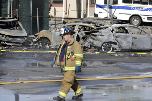 <div class='meta'><div class='origin-logo' data-origin='AP'></div><span class='caption-text' data-credit='AP Photo/Seth Wenig'>A firefighter walks near the site of a deadly small plane crash near Teterboro Airport in Carlstadt, N.J., just west of New York City, Monday, May 15, 2017.</span></div>