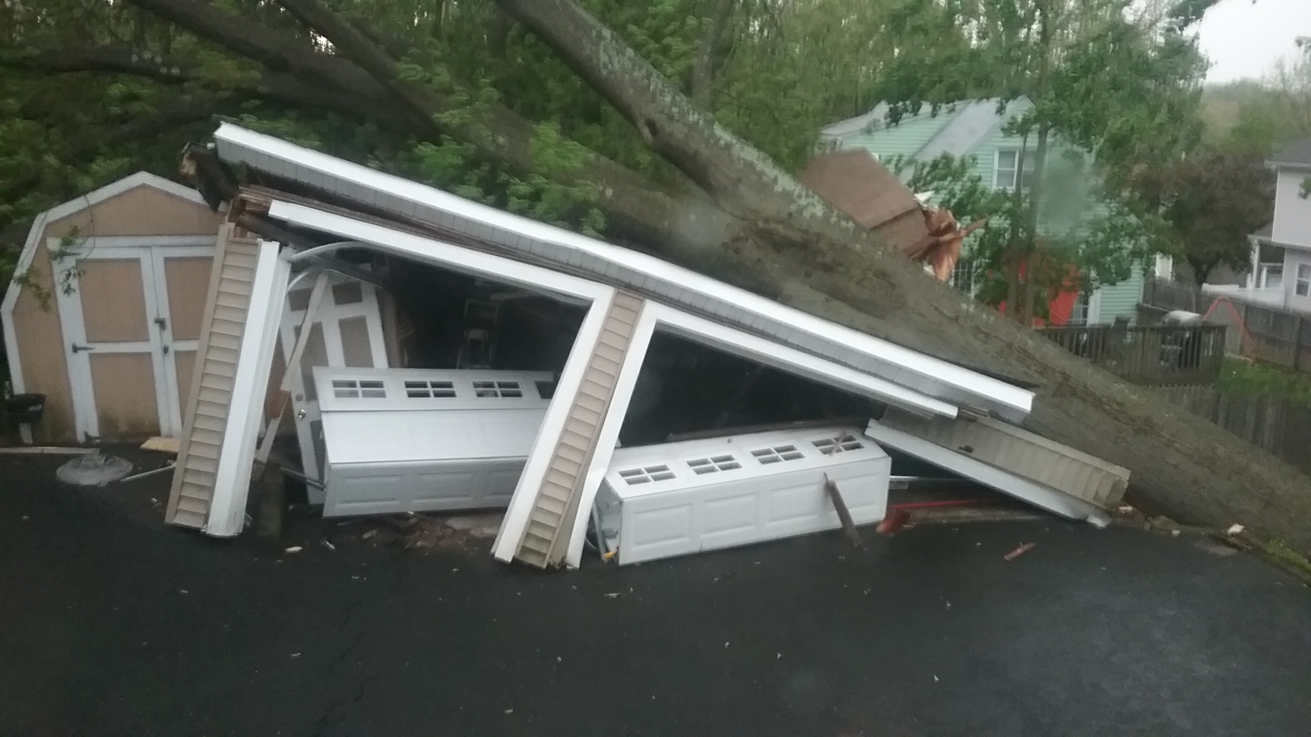 <div class='meta'><div class='origin-logo' data-origin='WABC'></div><span class='caption-text' data-credit='Al Vallese'>A tree fell during the storms, crushing a garage along Wilmuth Street in Mahwah, New Jersey.</span></div>