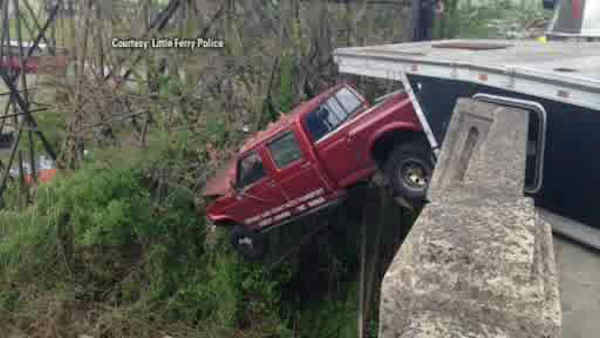 "<div class=""meta image-caption""><div class=""origin-logo origin-image ""><span></span></div><span class=""caption-text"">A man escaped unharmed after his truck crashed through a barrier leaving him dangling off of a bridge in Little Ferry Saturday.</span></div>"